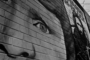 An emotional face painted on a brick wall in Bellfast
